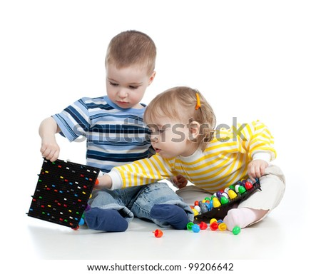 Children playing with  mosaic toy over white background