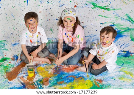 Children playing with painting with the background painted - stock photo