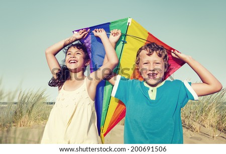 Children Playing with the Kite Outdoors - stock photo