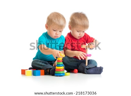 Children playing wooden toys together