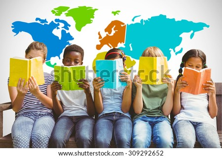 Children reading books at park against white background with vignette - stock photo