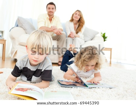 Children reading books in the living rooms - stock photo