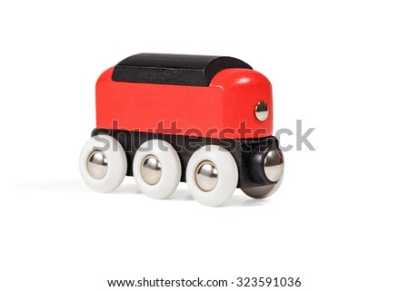 Children red black wooden car close-up isolated on white background - stock photo