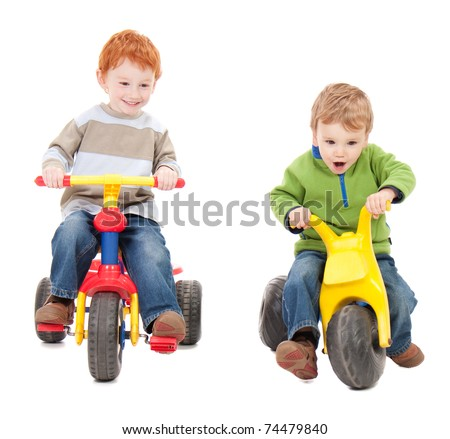 Children riding trycycles. Isolated on white. - stock photo