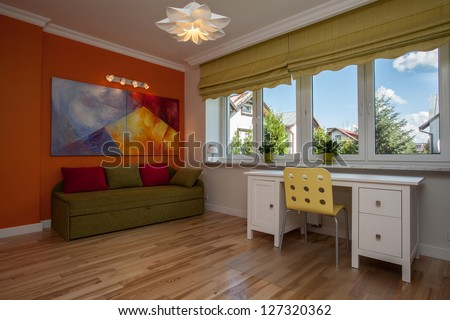 Children room with colorful sofa and walls - stock photo