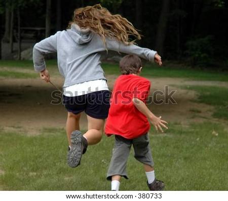 Children running and jumping - stock photo