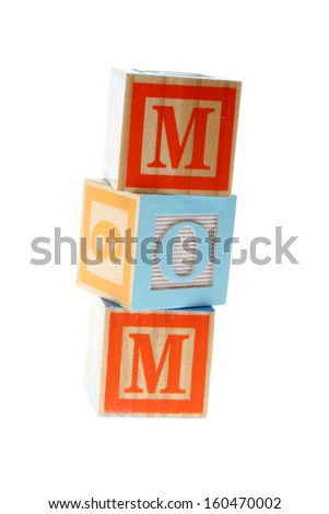 Children's Alphabet Blocks spelling the words mom  on white background on Education - stock photo