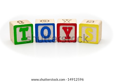 Children's alphabet letters wood blocks spelling the word toys, on white background - stock photo