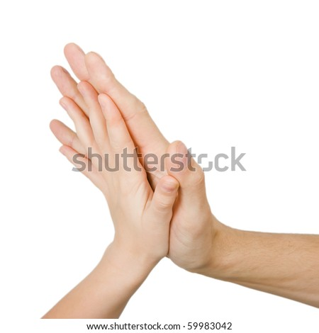 children's and men's hand touching on a white background - stock photo