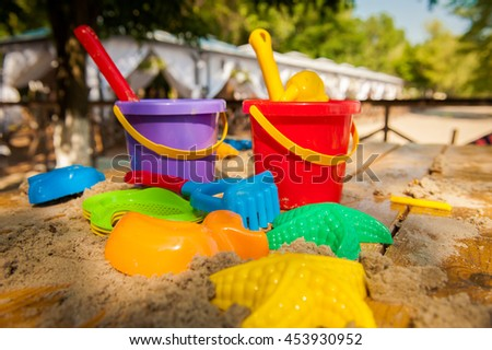 children's beach toys and sand. Children's beach toys - buckets, spade and shovel on sand on a sunny day. family vacation - stock photo
