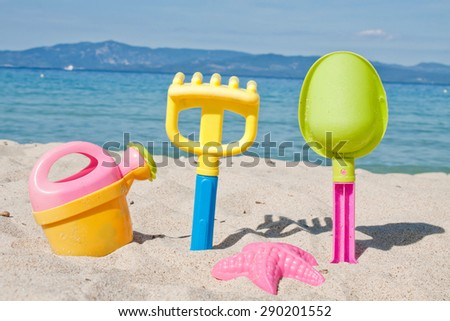 Children's beach toys - buckets, spade and shovel on sand on a  - stock photo