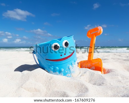 Children's beach toys on the sand - stock photo