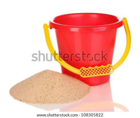Children's bucket and sand isolated on white - stock photo