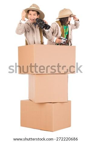 Children's couple in a cardboard box playing safari - stock photo