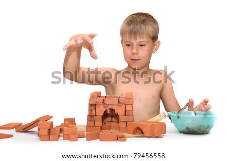 Children's designer. Child build a small house made of bricks - stock photo