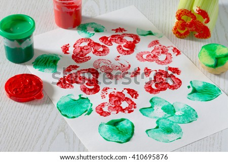 Children's drawing, made an imprint of celery and potatoes. Bouquet of roses. - stock photo