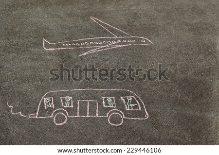 Children's drawing of bus and plane made chalk on the paving - stock photo