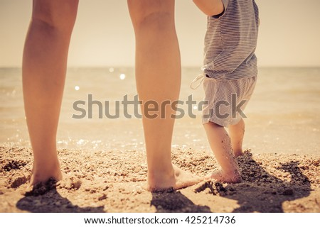 children's feet on the seashore - stock photo