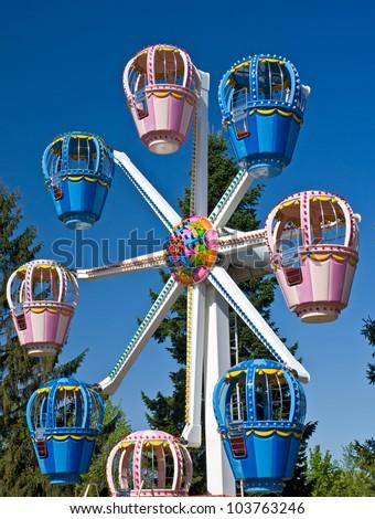 Children's Ferris wheel in Amusement Park - stock photo