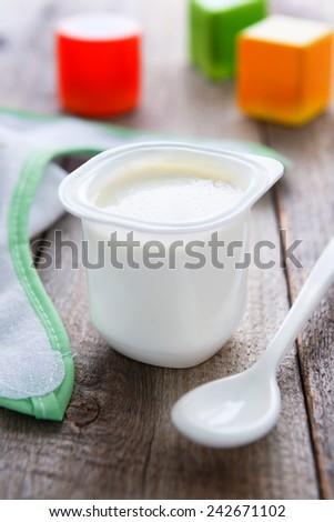 Children`s food: fresh cottage cheese - stock photo
