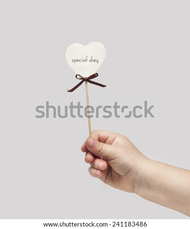"Children's hand holds the inscription ""special day"""