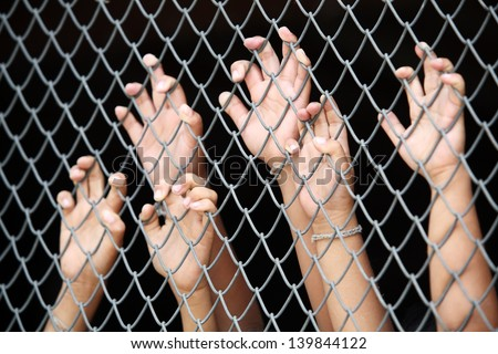 children's hand in jail.