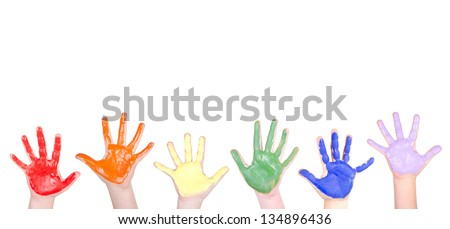 Children's hands painted in rainbow colors for a border isolated on white background