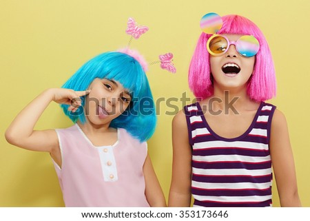 children's holiday.two little girls.funny kid friendship - stock photo
