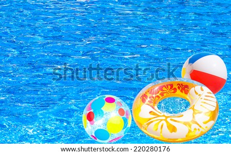 Children's inflatable circle and colorful ball on water