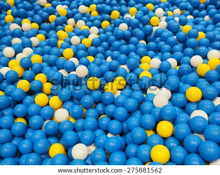 Children's party, a games room, a box filled with small colored balls. - stock photo
