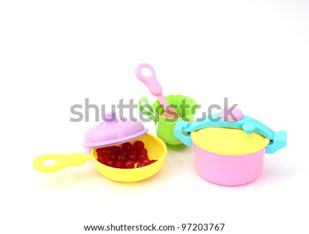 Children's plastic cookware, toys - stock photo