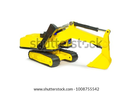 Children's plastic toy. The machine for digging the earth. Yellow color. Isolated on white background.