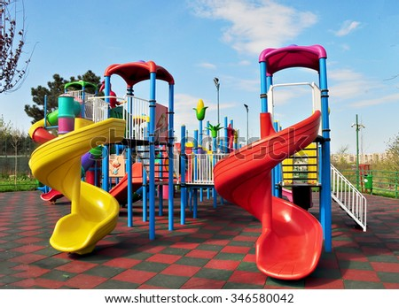 Children's play house in a park; - stock photo