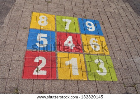 Children's playground: Colorful hopscotch with numbers one to nine