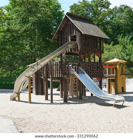 Children's playground in the park - stock photo