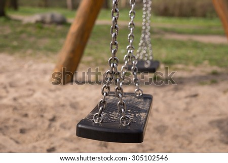 Children's playground swing - stock photo
