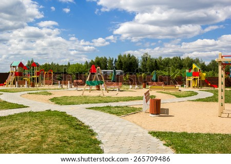 children's playground with swings and slides countryside - stock photo