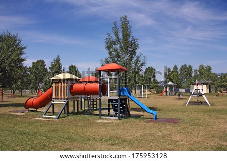 Children's school playground with swings and slide the blue