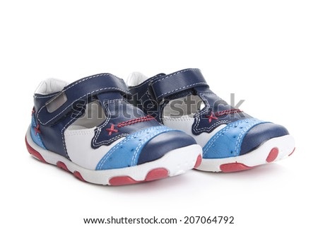 Children's Shoes for kids isolated over a white background. - stock photo