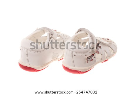 Children's shoes. Isolated on white background in the closeup.  - stock photo