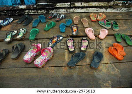 Children's Shoes on Porch - stock photo