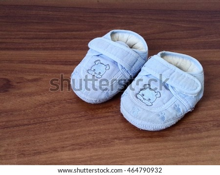 Children's shoes on the wooden floor