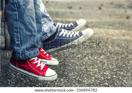 Children's shoes. Red shoes. - stock photo