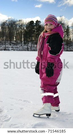 Children's skating on the lake - stock photo