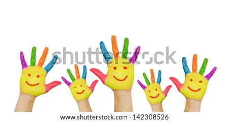 Children's smiling colorful hands raised up. The concept of classroom or back to school. Isolated on white background - stock photo