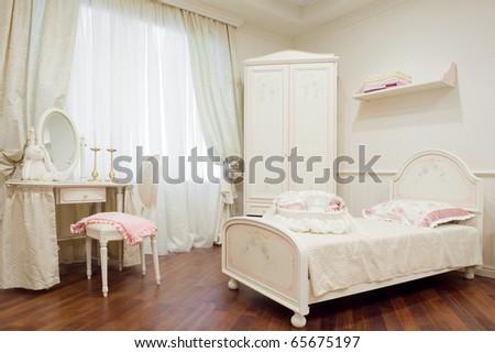 Children's stylish bedroom cream color - stock photo