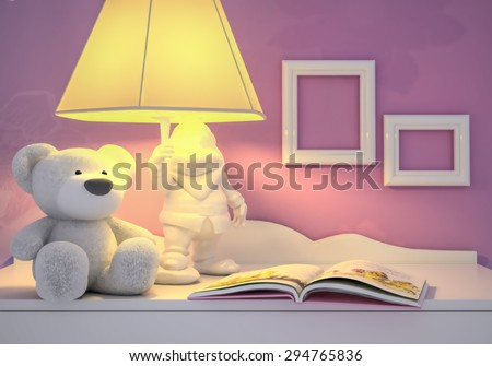 Children's toy, book, the lamp are located on a table. - stock photo