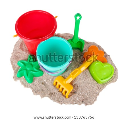 Children\'s toys on sand isolated on white - stock photo