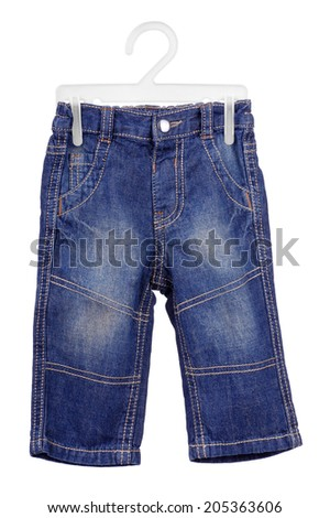 Children's wear - jeans isolated over white background.