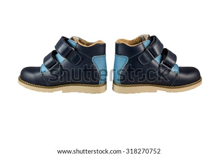 Children's winter leather shoes on a white background